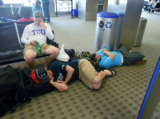 Three Tuckered Out Young Men... Brad with Chris and Sean laying on the Floor at the Airport