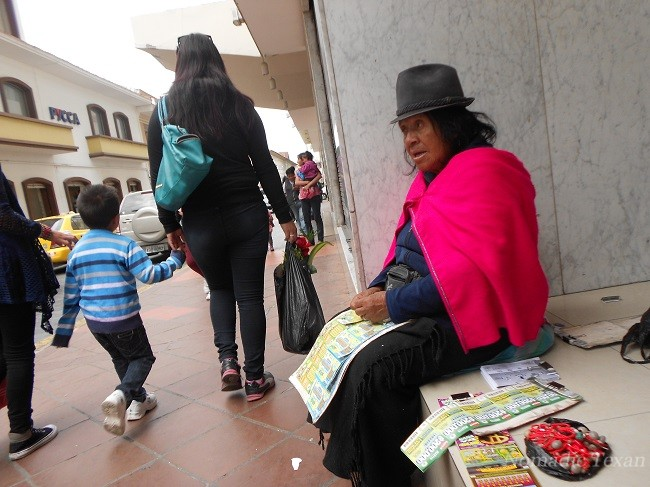 Indingenous Lady Selling Lottery Tickets