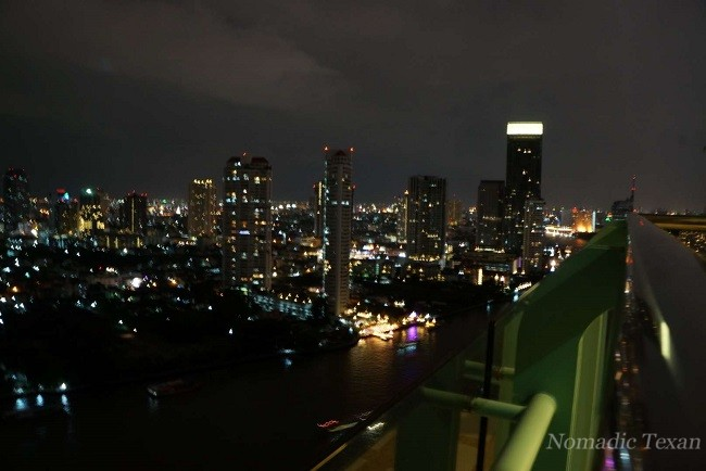 View of the Chao Phraya River at Night from a Chatrium Balcony