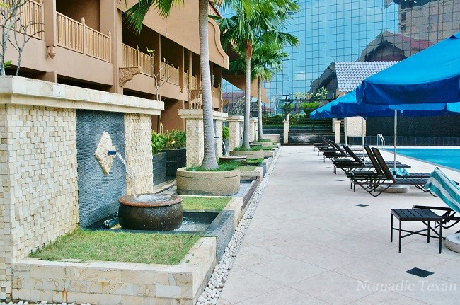 Walkway Beside Pool with Fountains