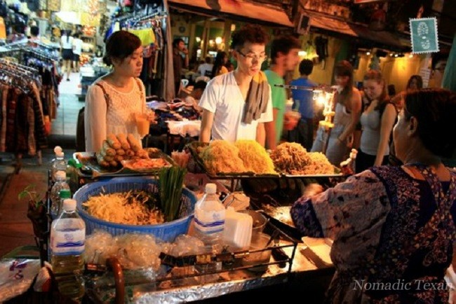 Tourist Ordering Pad Thai in Bangkok